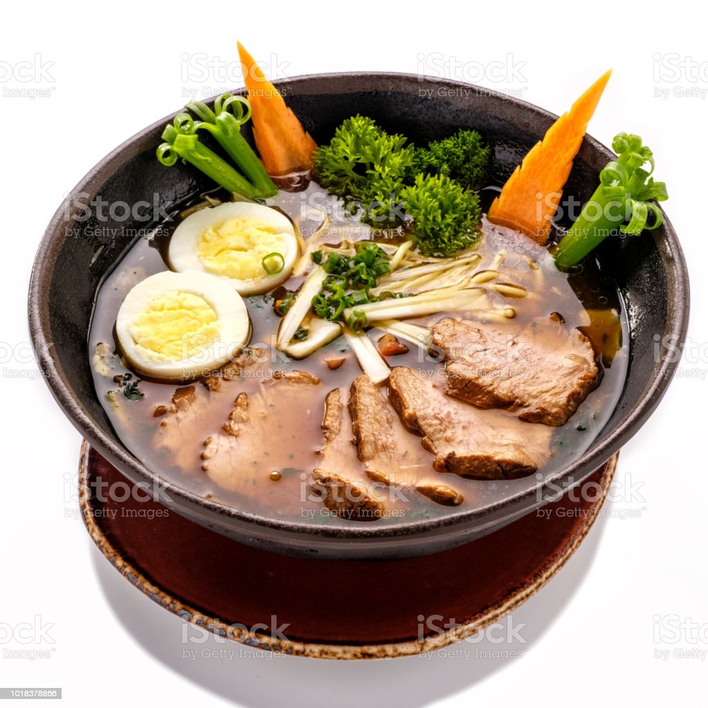 Plate of Ramen Soup with noodles and beef. стоковое фото