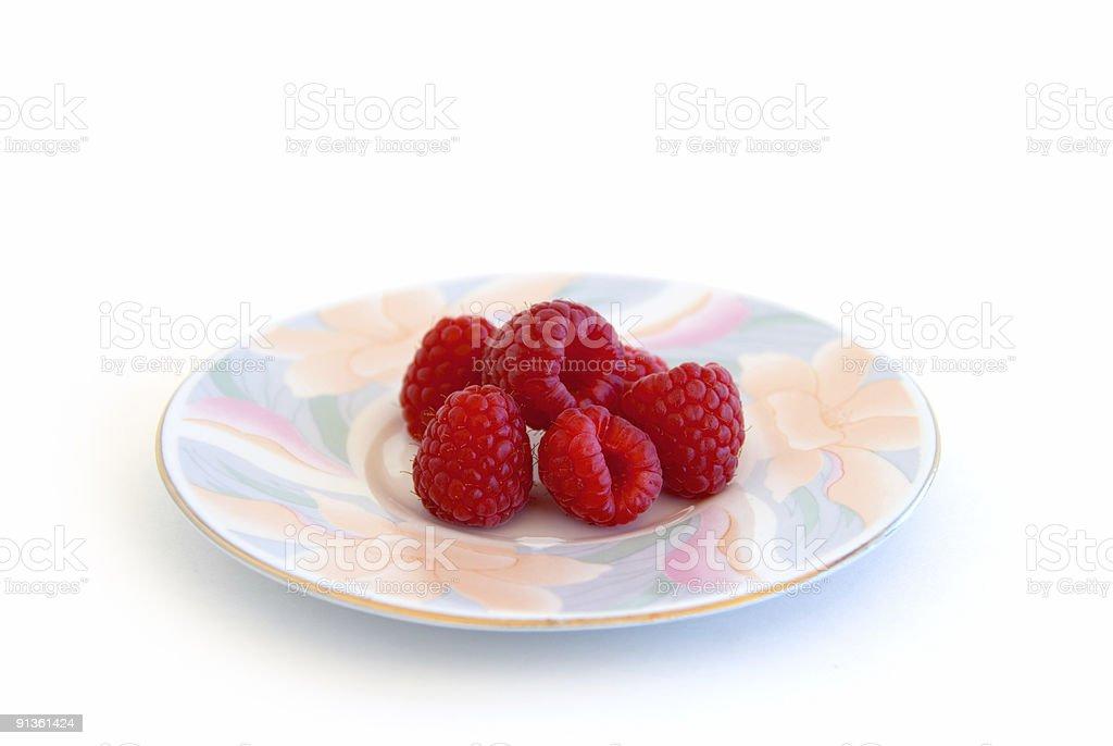 Plate of raspberries royalty-free stock photo