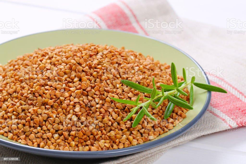 plate of raw buckwheat stock photo