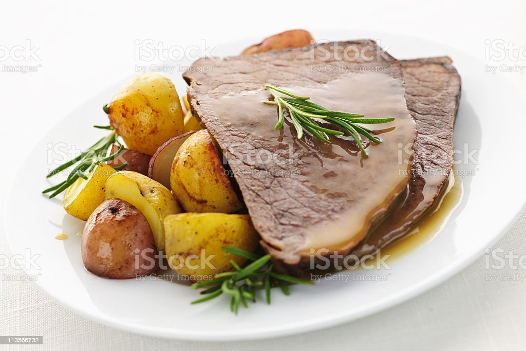 Plate of roast beef, potatoes, garnished stock photo