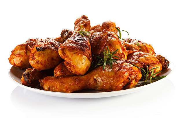 A plate of roasted chicken drumsticks