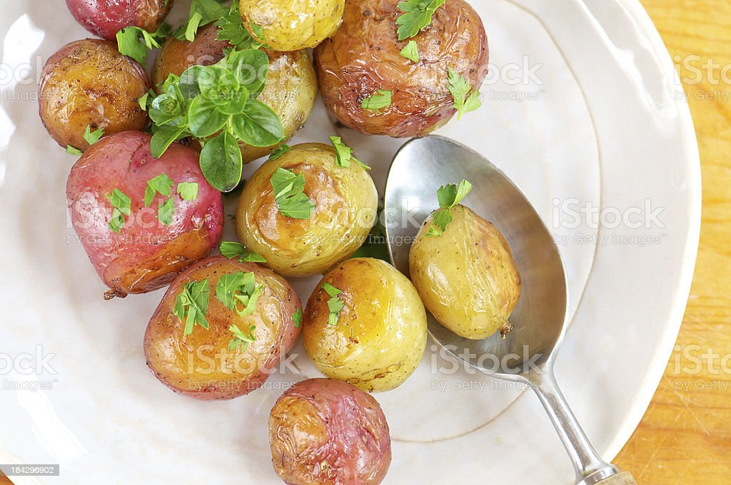 Plate of Roasted New Potatoes from Above with Spoon royalty-free stock photo