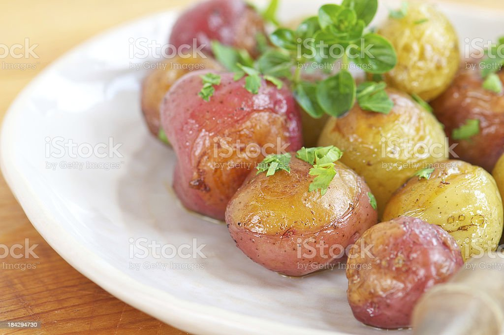 Plate of Roasted New Potatoes royalty-free stock photo