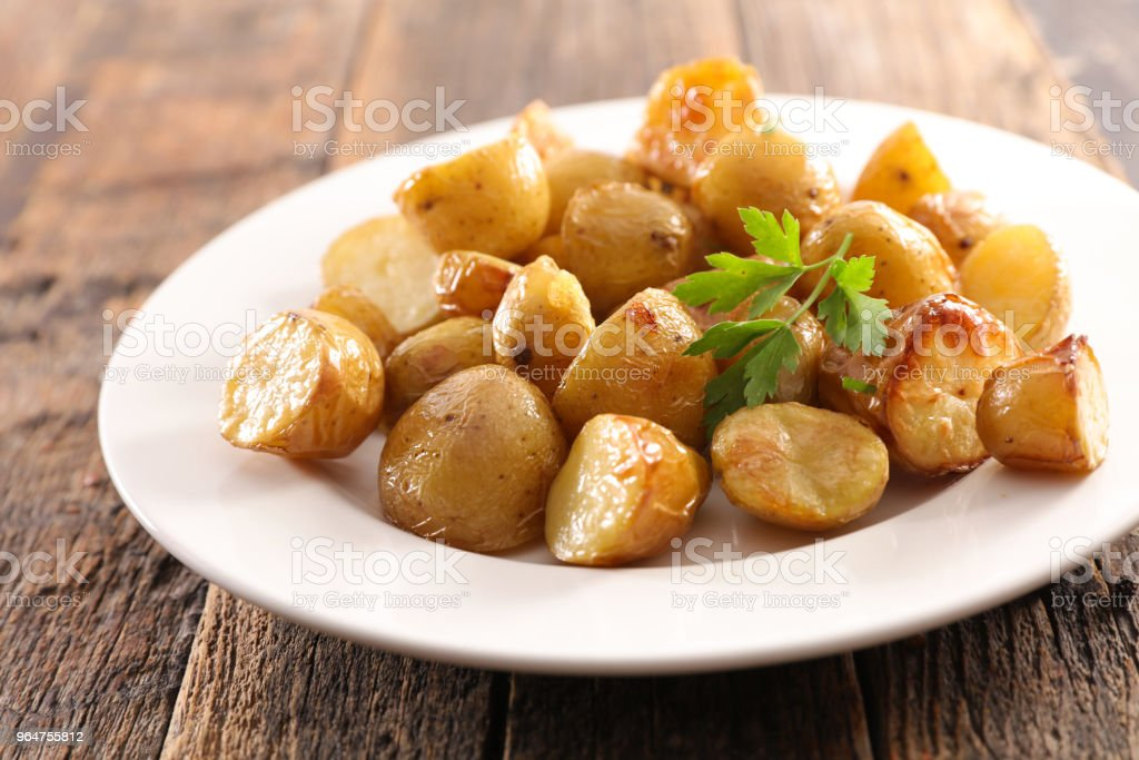 plate of roasted potato royalty-free stock photo