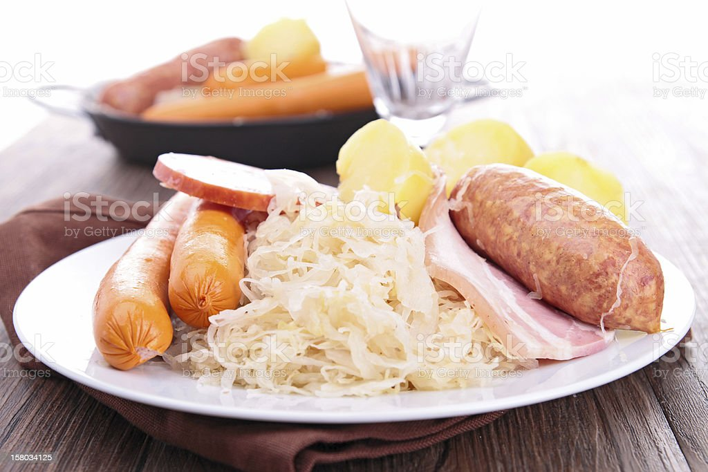 A plate of sauerkraut and other foods on a set table stock photo