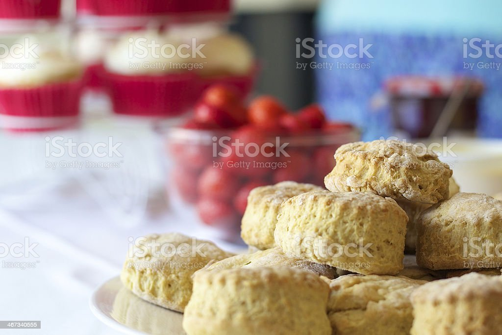 Plate of scones with strawberries and jam stock photo