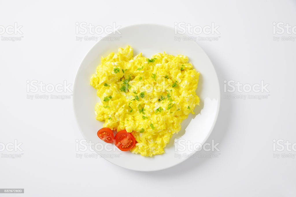 plate of scrambled eggs stock photo