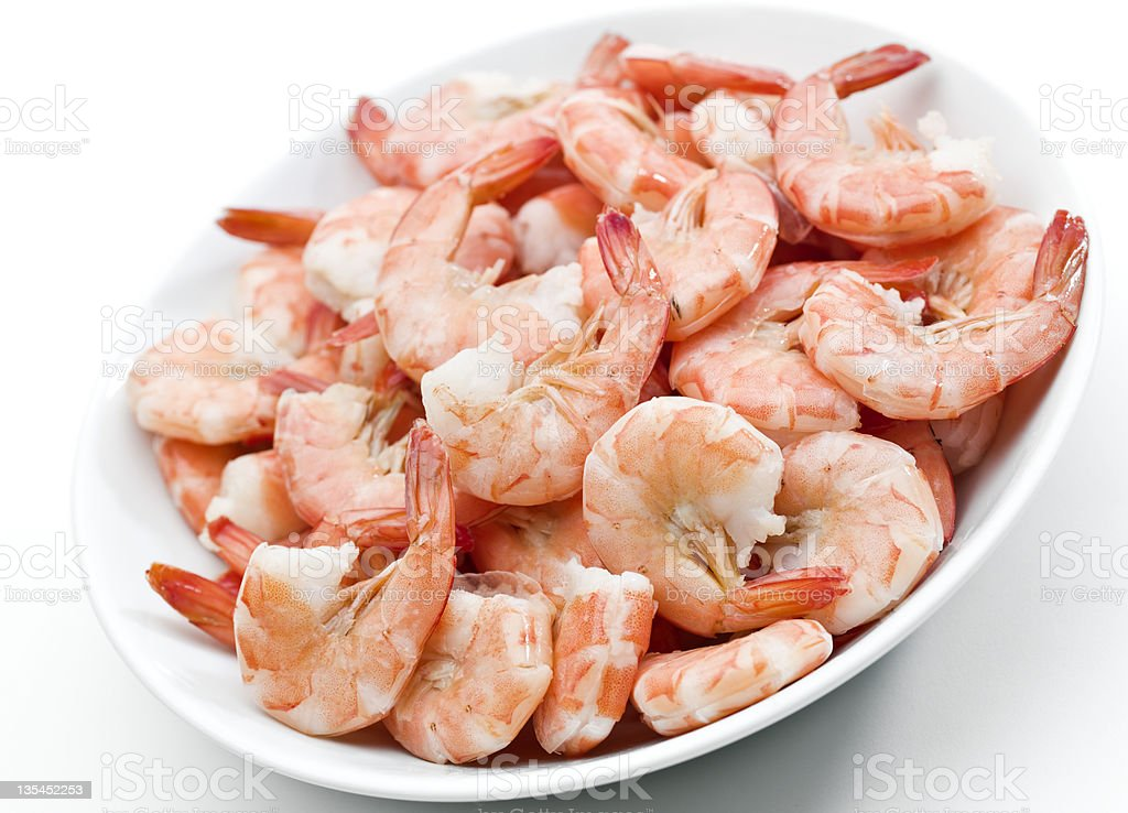 Plate of shrimps on white background stock photo