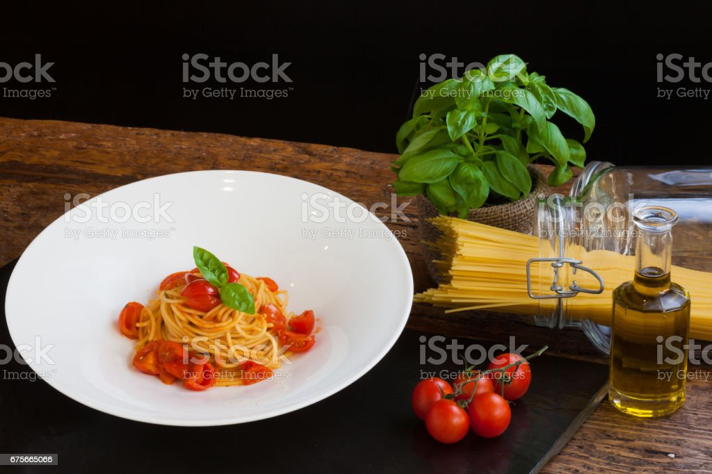 Plate of Spaghetti with Fresh Tomato and Basil royalty-free stock photo