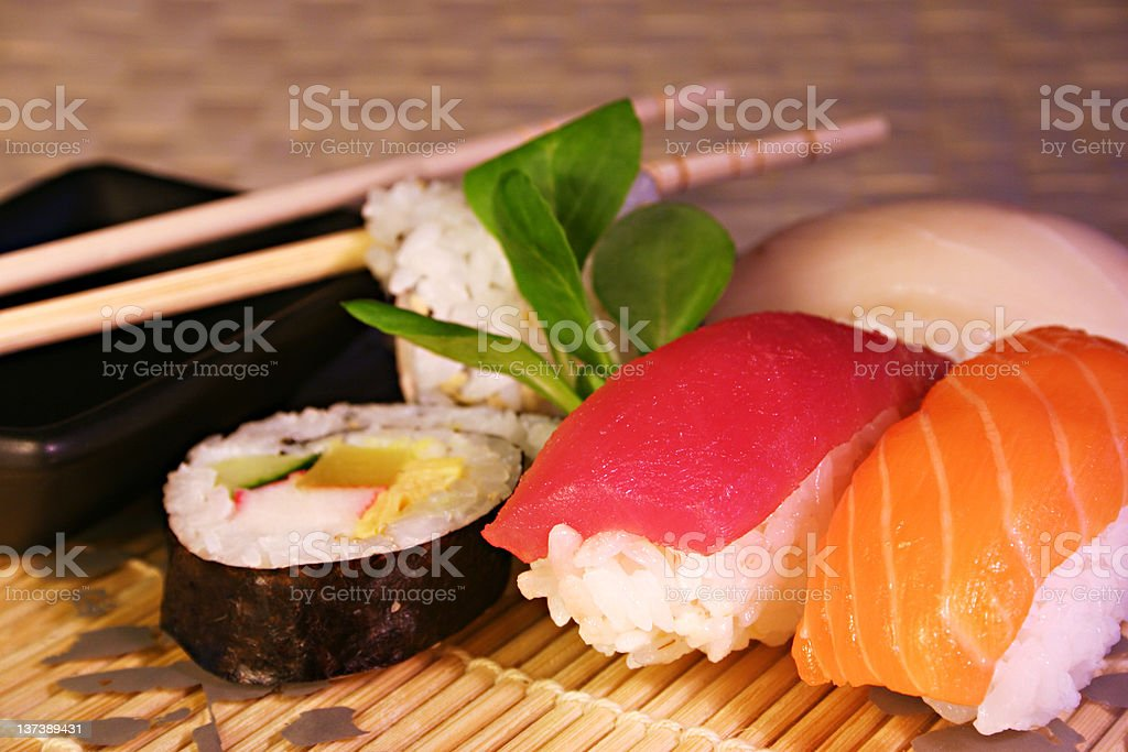 A plate of sushi and sashimi with chopsticks royalty-free stock photo