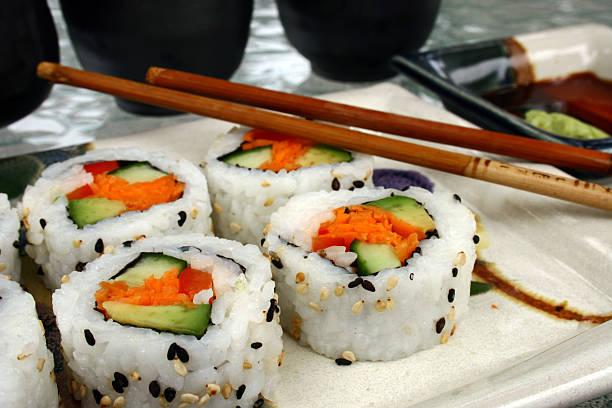 plate of sushi - california rolls stock photo