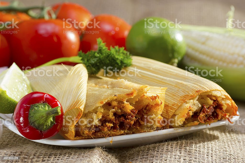 Plate of tamales with fresh vegetables stock photo