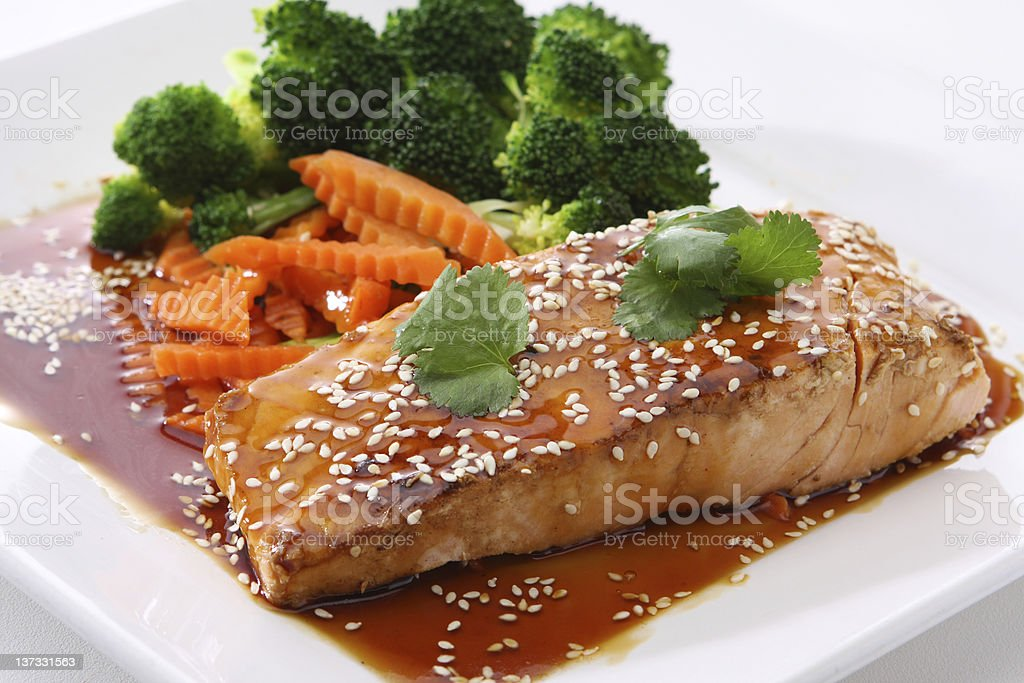 A plate of teriyaki salmon with vegetables stock photo