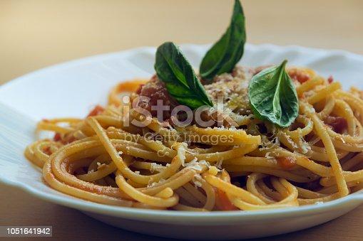 istock Plate of tomato and basil spaghetti. 1051641942