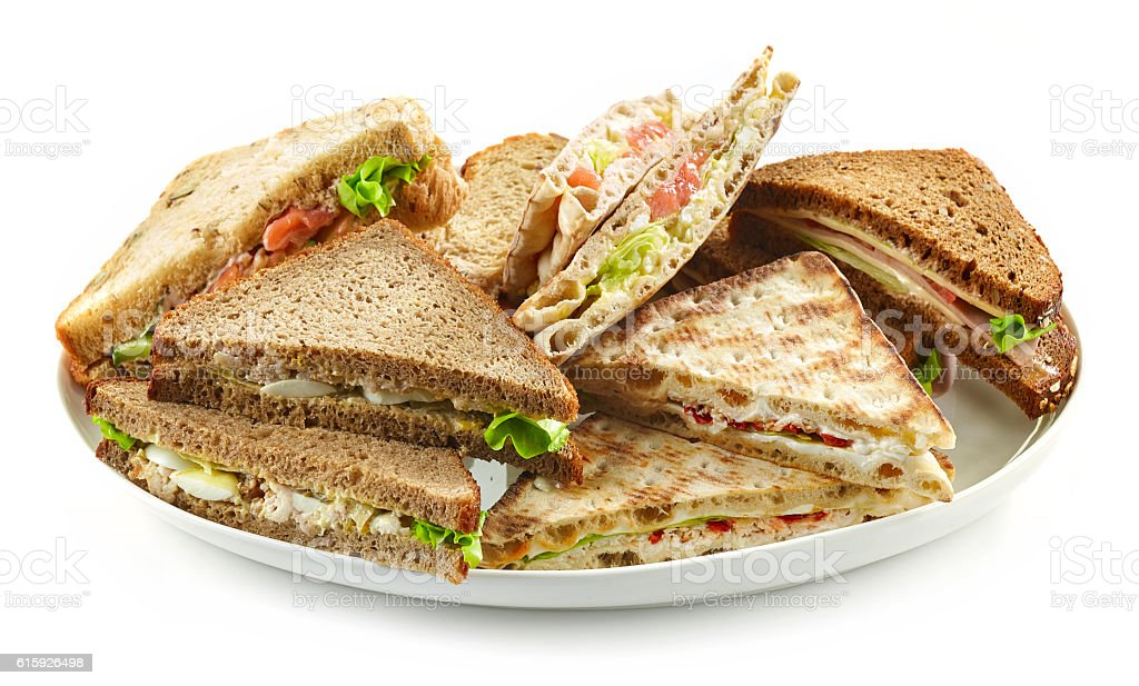 plate of various triangle sandwiches stock photo
