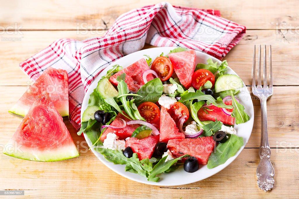plate of watermelon salad stock photo