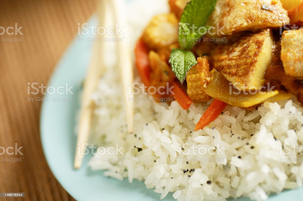 A plate of white rice with vegetables on top royalty-free stock photo