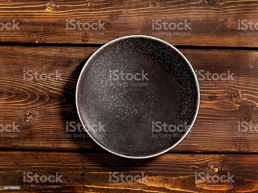 Plate on a Weathered Wood Table stock photo