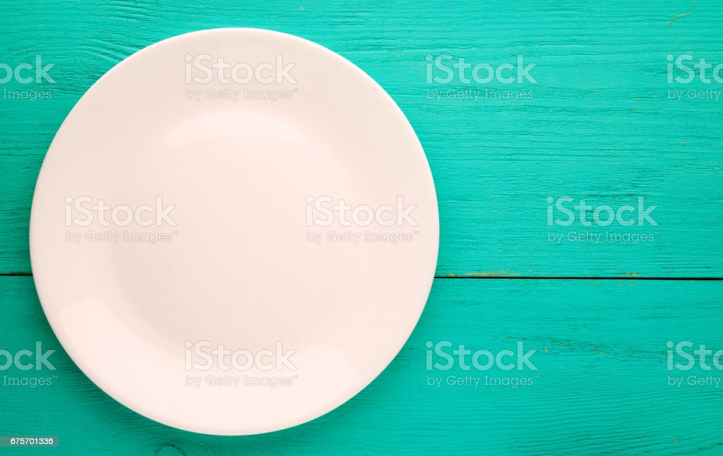 plate on a wooden background.white plate. plate top view. copy space royalty-free stock photo