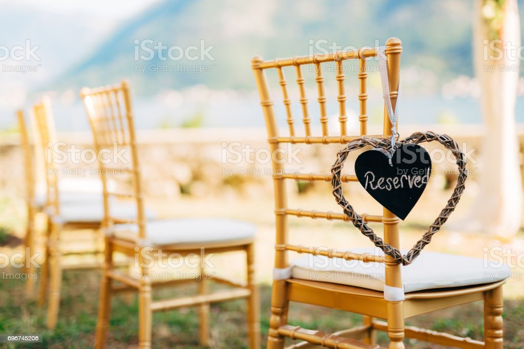 Plate Reserved on the chair at the wedding stock photo