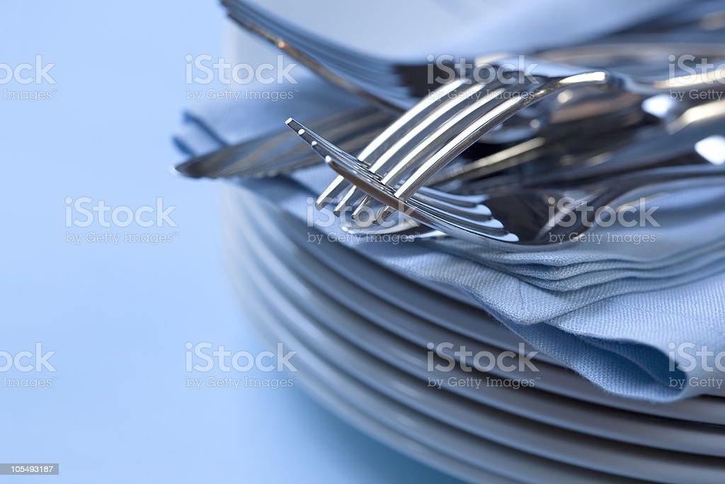 Plate Stack and Cutlery royalty-free stock photo