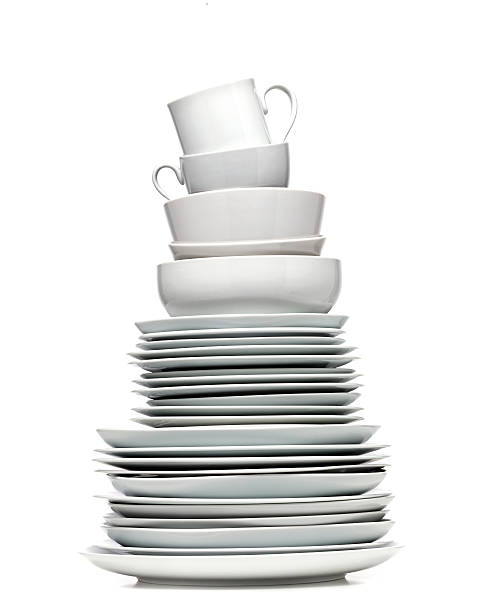 Plate Tower Collection of white plates, bowls and cups. crockery stock pictures, royalty-free photos & images