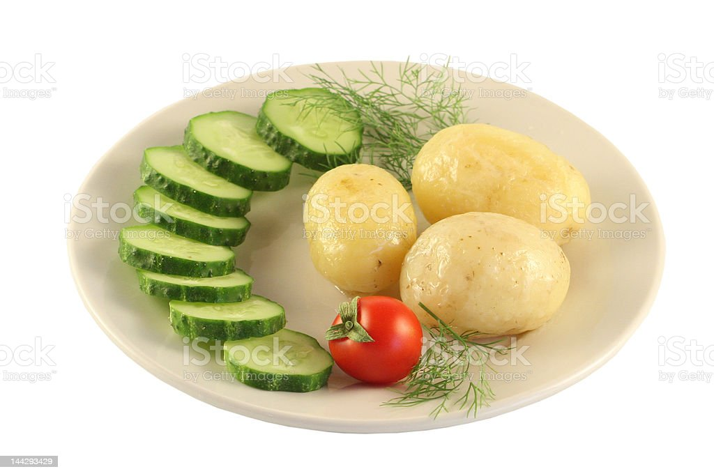 Plate with a potato. royalty-free stock photo
