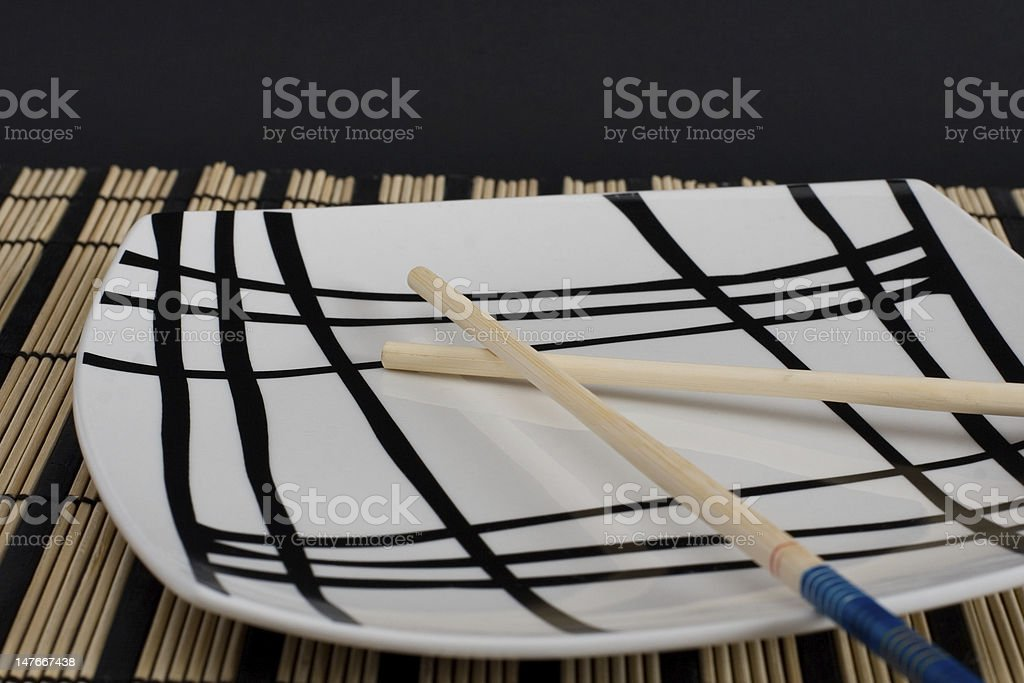 plate with bamboo chopsticks royalty-free stock photo