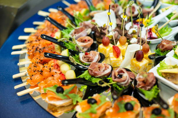 Plate with canapes and snacks, close up. stock photo