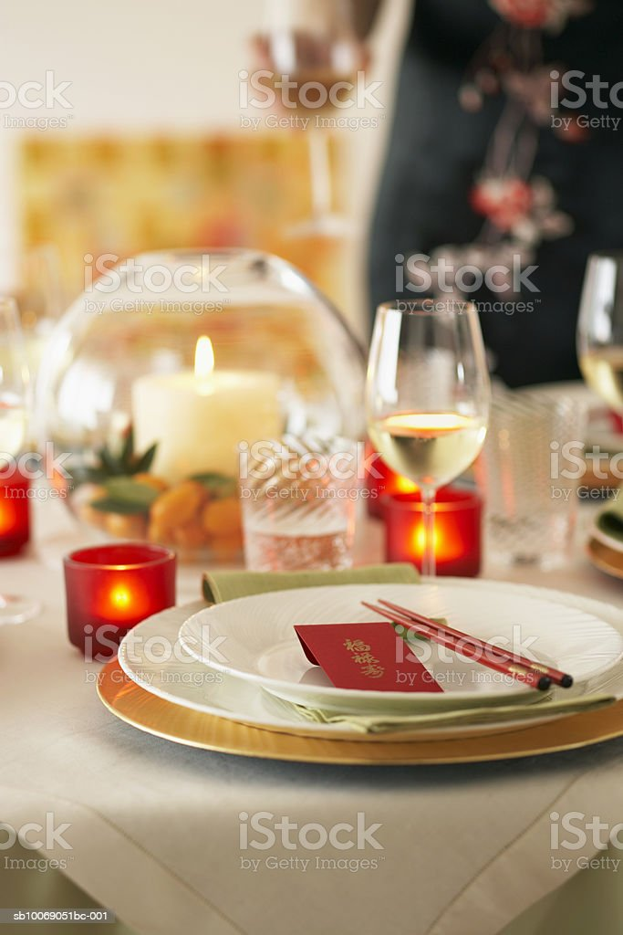 Plate with chopsticks on table, person in background royalty free stockfoto