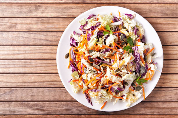 plate with coleslaw - coleslaw stock pictures, royalty-free photos & images