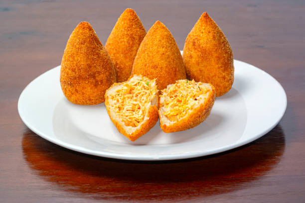 Plate with coxinhas, a typical croquette of Brazil. Photo of a plate with coxinhas, a typical croquette of Brazil. coxinha stock pictures, royalty-free photos & images