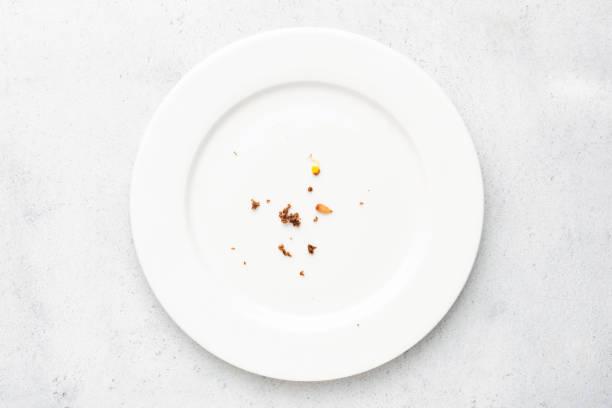 tallrik med smulor matrester - tallrik uppätet bildbanksfoton och bilder