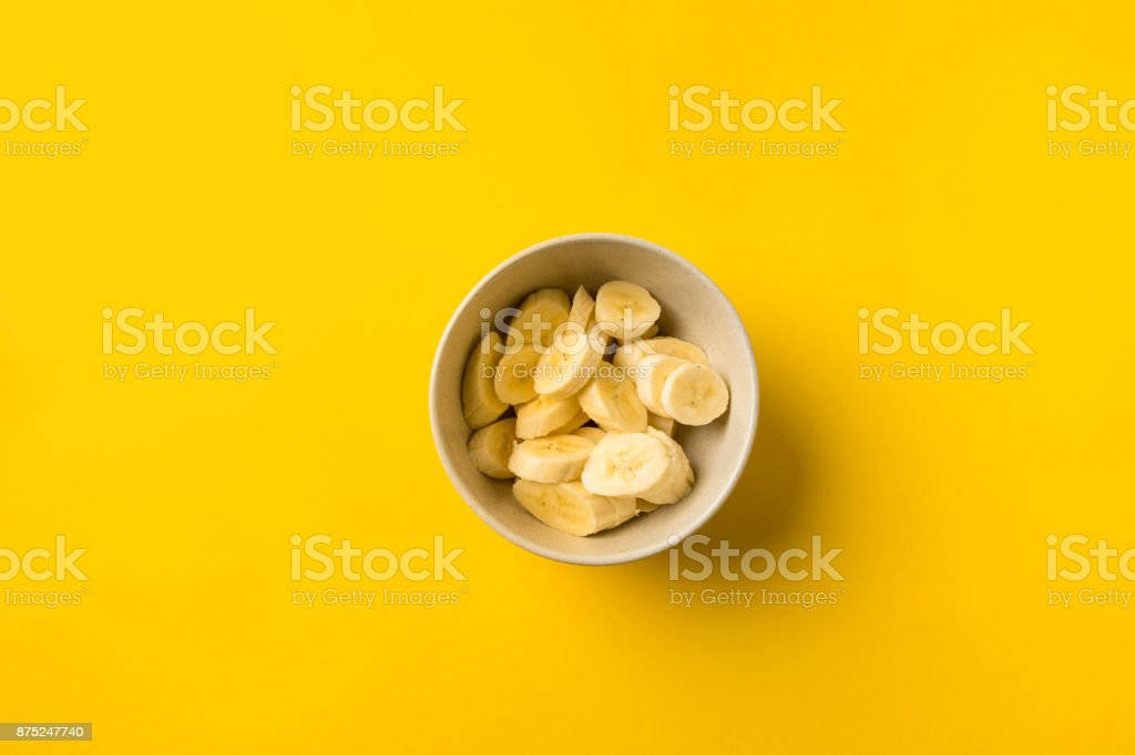 Plate with cut bananas stock photo