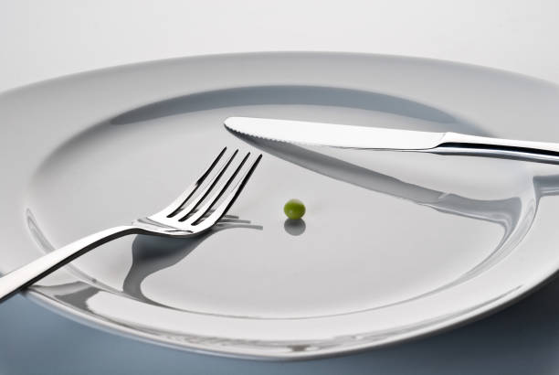 Plate with cutlery and a pea stock photo