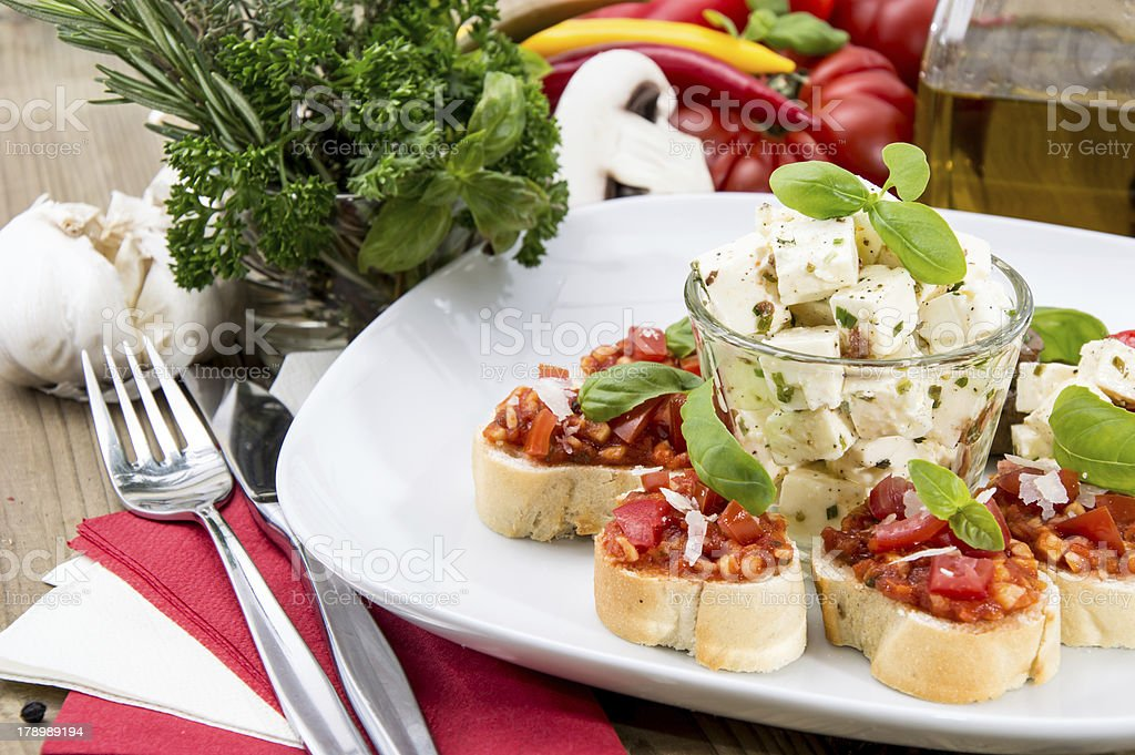Plate with Feta Cheese and Bruschetta royalty-free stock photo