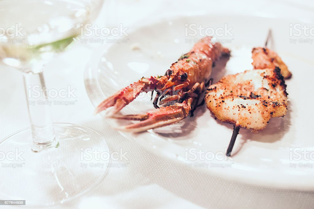 Plate with fresh grilled scampi stock photo