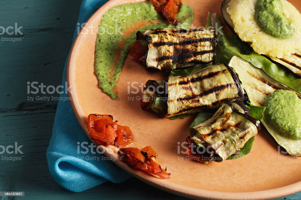 Plate with grilled eggplants closeup stock photo