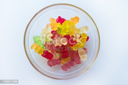 istock Plate with jelly bears on a white background. Flat lay. 1255512366