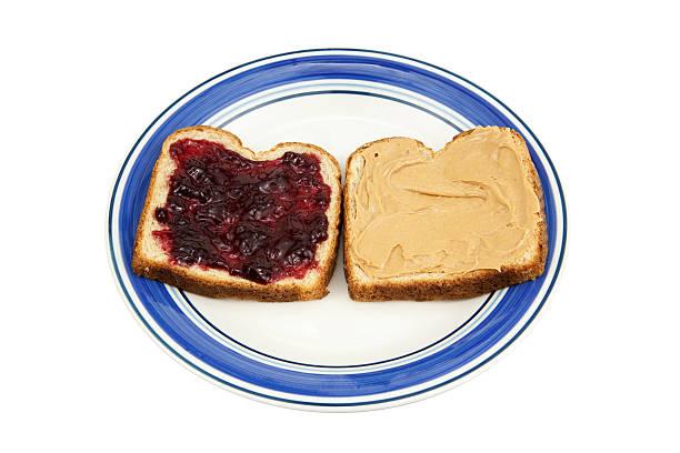 plate with peanut butter and jelly - peanutbutter bildbanksfoton och bilder