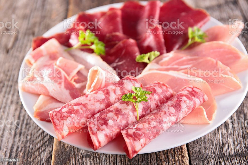 plate with salami,ham,bacon and speck stock photo