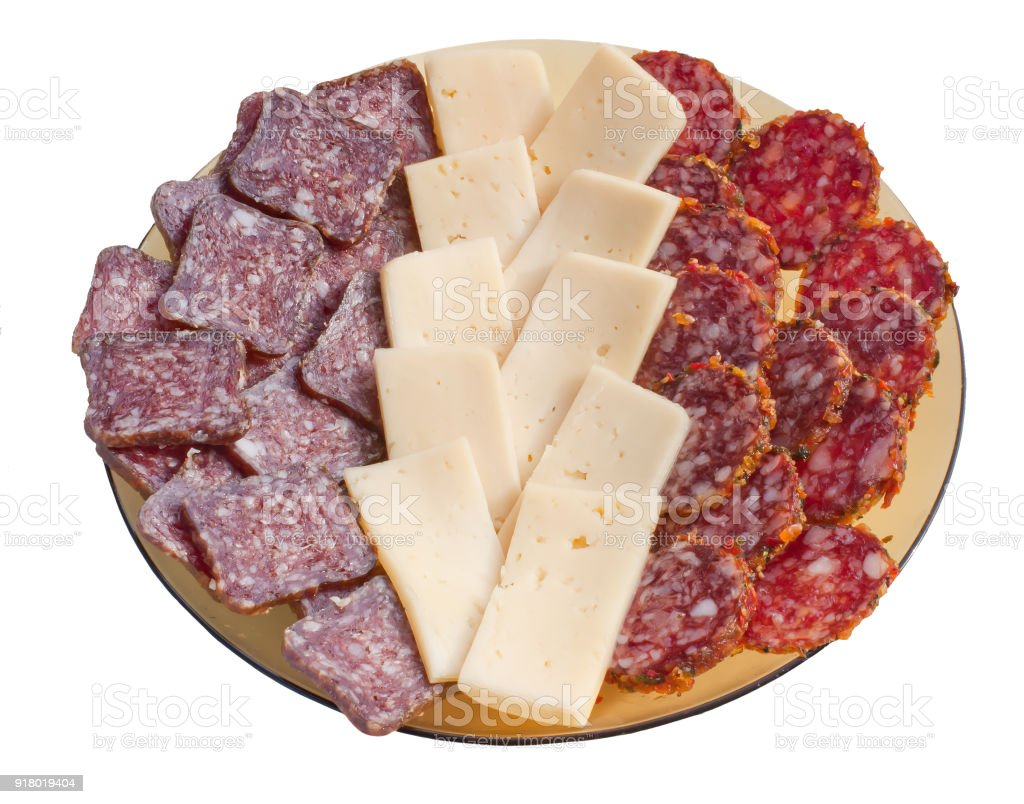A plate with slices of sausage and cheese isolated on white background stock photo