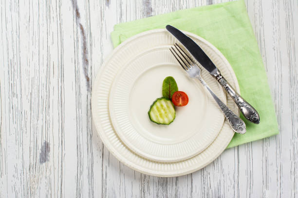 plate with small portion of food - serving size stock photos and pictures