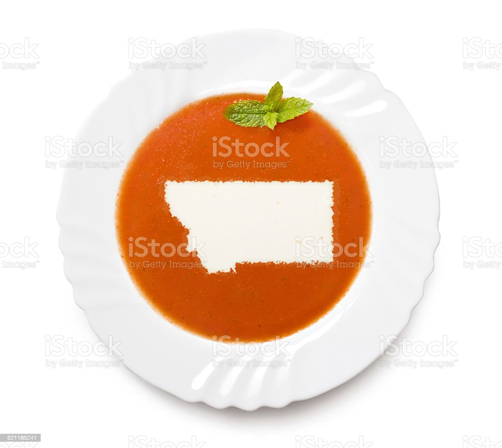 Plate with tomatosoup and cream (shape of Montana) stock photo