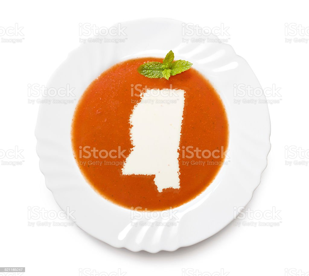 Plate with tomatosoup and cream (shape of Mississippi) stock photo