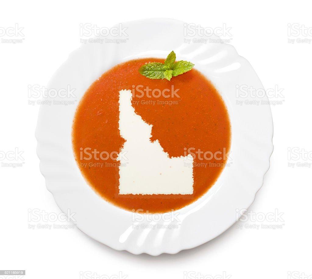 Plate with tomatosoup and cream (shape of Idaho) stock photo
