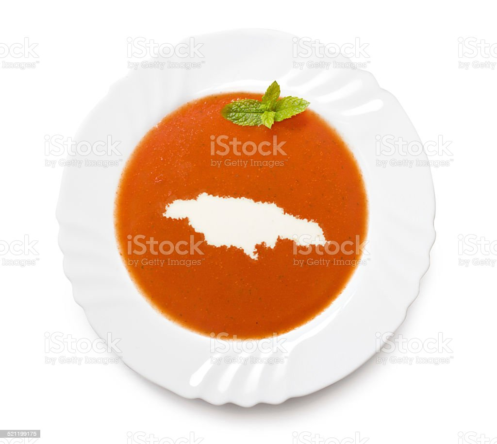Plate with tomatosoup and cream (shape of Jamaica) stock photo