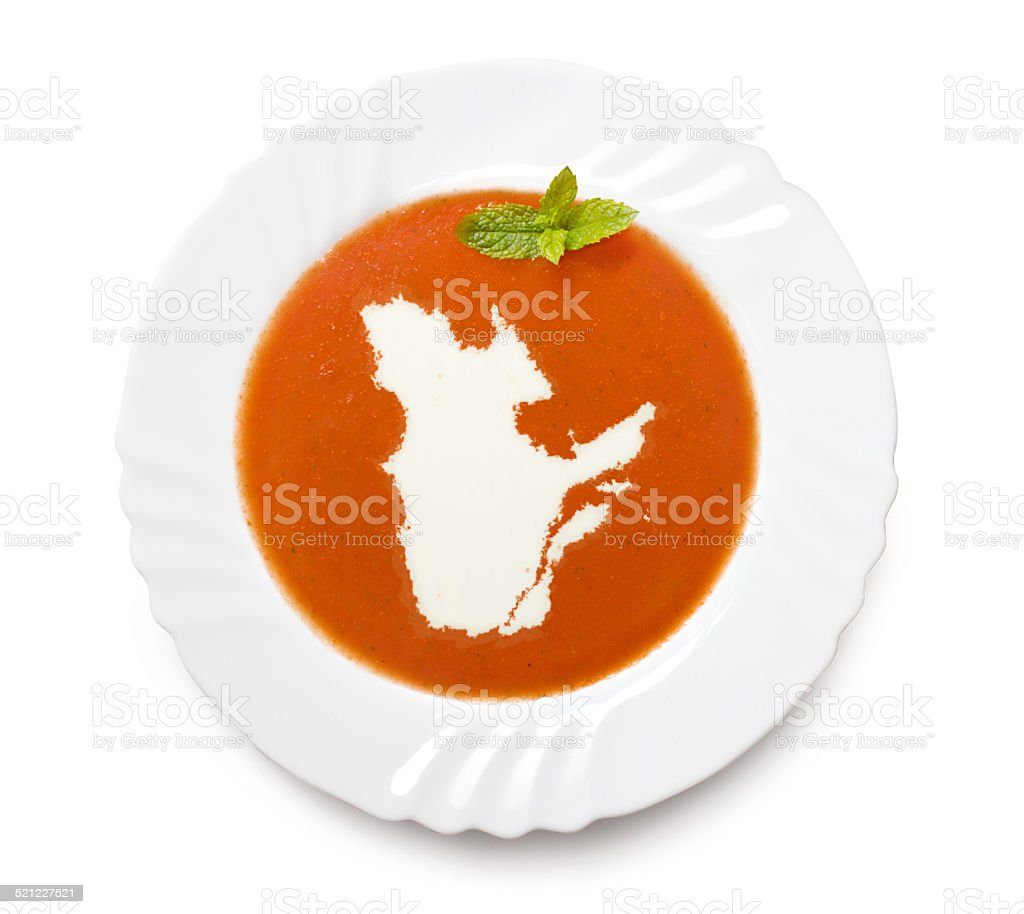 Plate with tomatosoup and cream (shape of Quebec) stock photo