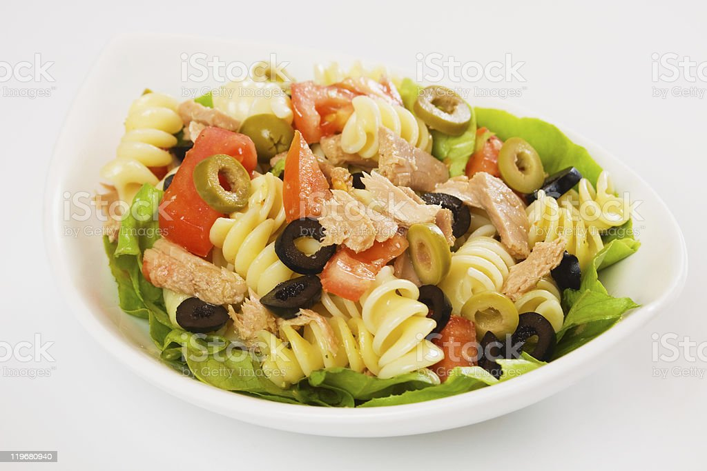 Plate with tuna, pasta, tomato, lettuce and olive salad stock photo