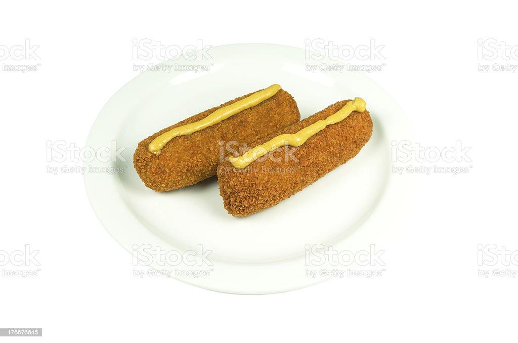 Placa con dos croquettes de carne de res. foto de stock libre de derechos